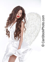 Long wavy Hair. Model Angel Girl in blowing dress with white...