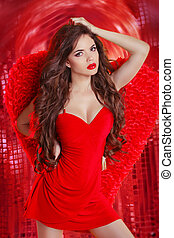 Sensual angel girl in red dancing over disco ball lights...