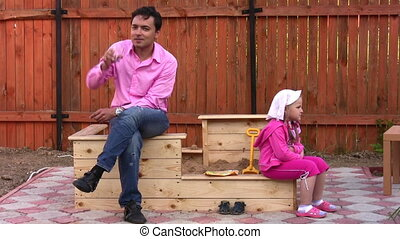 father with little girl outdoor