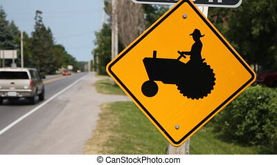 Tractor sign in rural area Prince Edward County, Ontario,...