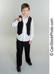 boy giving thumbs up sign - Full length portrait of happy...
