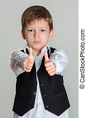 boy giving thumbs up sign - Portrait of boy showing thumbs...