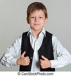 boy giving thumbs up sign - Portrait of happy boy showing...