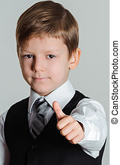 boy giving thumbs up sign - Portrait of schoolboy showing...