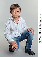 boy model - portrait of boy wearing in white shirt and blue...