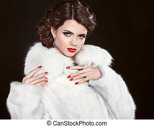 Beauty Fashion Model Girl in white fur coat. Beautiful Luxury Wi