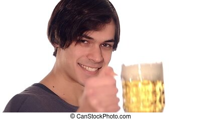 young man drinking a beer over white background