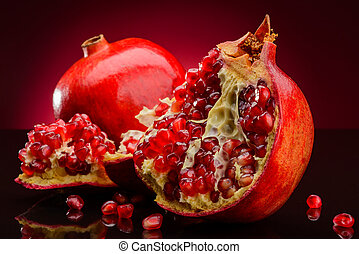 red pomegranate on dark background - red pomegranate fruits...