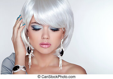 Beauty blond girl model with fashion earrings and White...