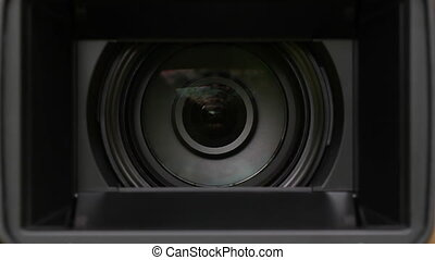 Video camera zoom.