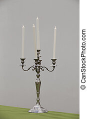 Candlestick - candlestick on table with green table cloth