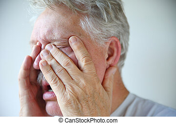 Cold or flu symptoms in a senior man - A senior man...
