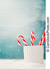 Candy canes - Christmas background Candy canes on snow, Xmas...