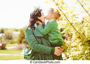young mother and her son spending time outdoor - happy...
