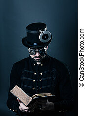 steam punk man reading - man in steampunk outfit with a hat...
