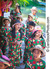 Filipino kids dancing on the Loboc River at Philippines -...