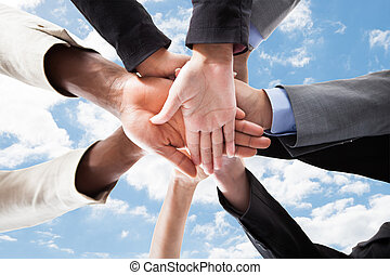 Multiethnic Businesspeoples Hands On Top Of Each Other -...