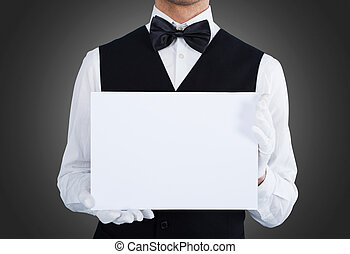 Midsection Of Waiter Holding Blank Billboard - Midsection of...
