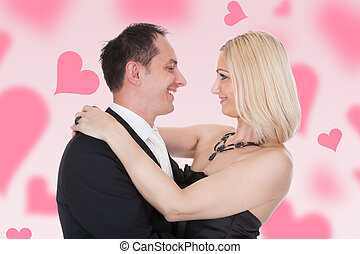 Couple Embracing Amidst Hearts - Happy couple embracing...