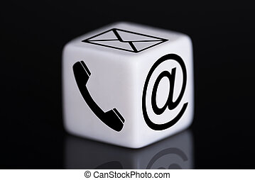 White Dice With Mail And Phone Icons - Closeup of white dice...