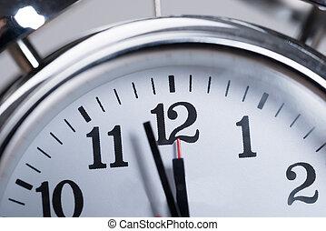 Alarmclock - Closeup photo of alarmclock. Almost noon time