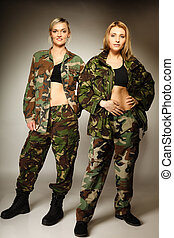two women in military clothes army girls - Full length two...