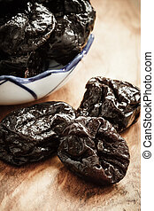 dried plums prunes on wooden table - Healthy food, good...