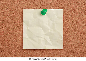 Blank Note Pinned On Cork - A blank note is pinned to a...