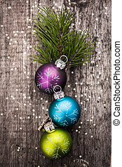 Christmas decoration ball on textured grungy wooden surface...