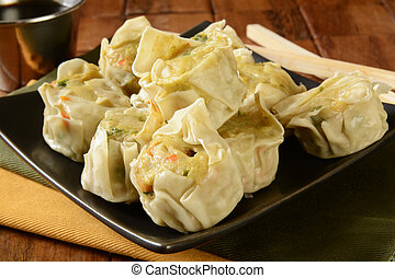 Chicken Shu Mai closeup - Close up of Chicken dumplings with...