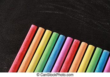 Colorful Chalks On Blank Blackboard - Blank blackboard...