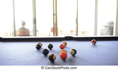 Cheating At Pool - A person cheats and steals a billiard...