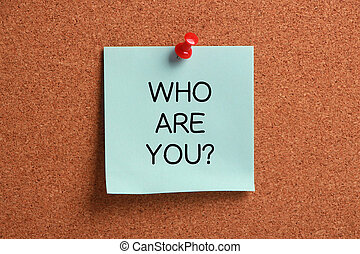 Who Are You? - Who Are You sticky note pinned on cork.