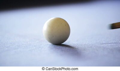 Playing Pool on Pool Table - Close up of pool cue striking...