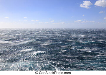 Blue skies and stormy winds at sea