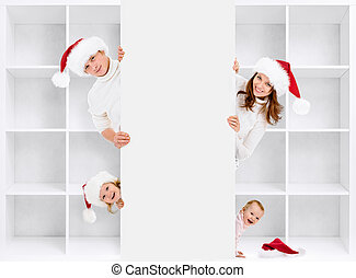 Christmas family in Santa's hats with shelving