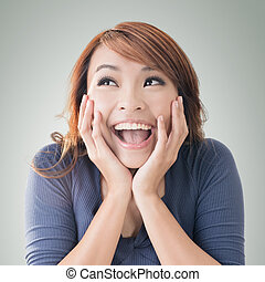 Excited happy Asian girl face, closeup portrait
