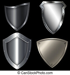 Medieval silver shield set. Isolated object on black...