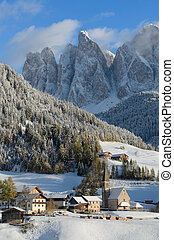 Dolomites village in winter - The church of St. Magdalena or...