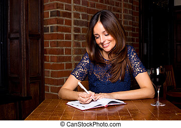 young woman writing in diary