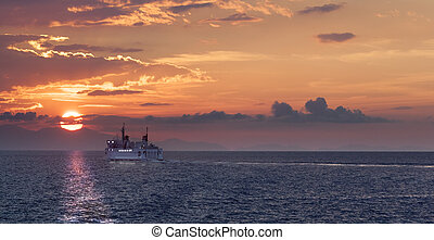 The last ferry - Sunset on the sea after a stromy day near...