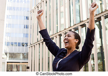 young business woman celebrating