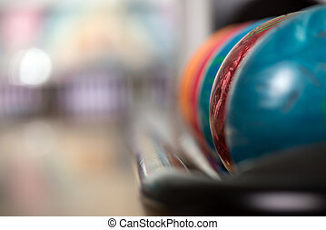Bowling - Close-up a group of colored bowling balls in the...