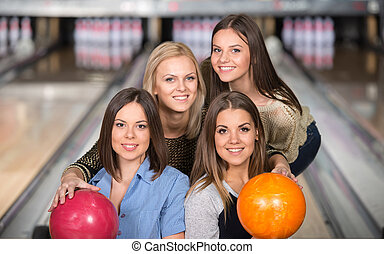 Bowling - Portrait of four happy women in bowling are...