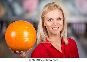 Bowling - Beautiful young woman in a bowling alley with...