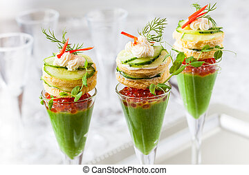 festive appetizers with avocado puree, red caviar and...
