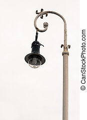 Streetlight - Outdoors shot of a streetlight over a grey...