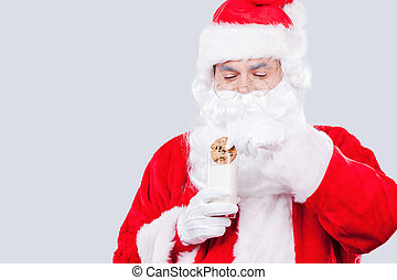 My favorite cookies Traditional Santa Claus holding cookie...