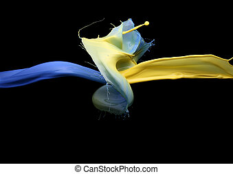 Paint splash - impingement of blue and yellow paint on a...