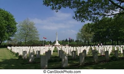 Cross of Sacrifice and headstones at Groesbeek Canadian War Cemetery + pan